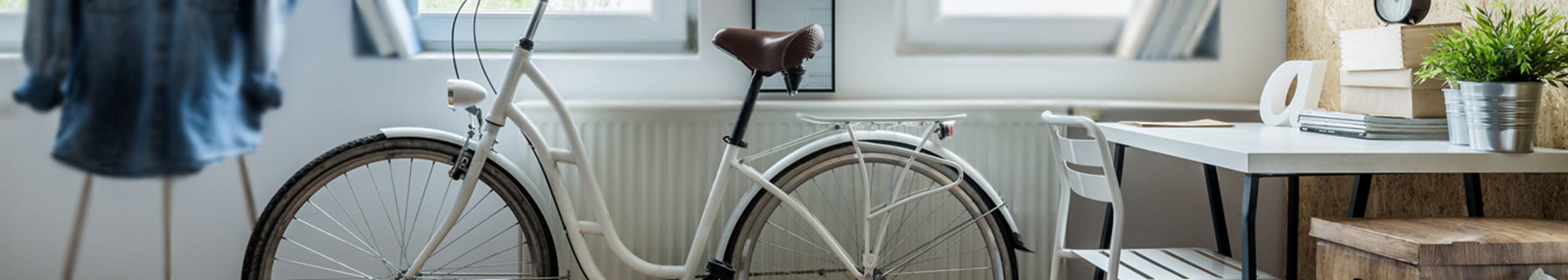 A bicycle next to a radiator